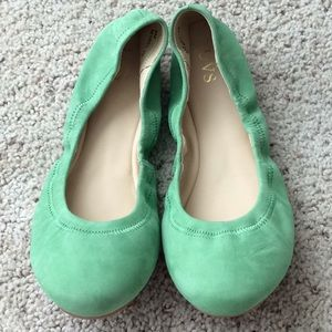 UVS green leather flats. NWOT. Size 8.